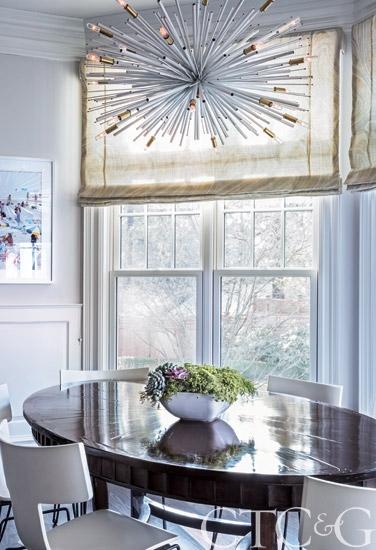 roman shade window treatment with sputnik mid-century chandelier 1